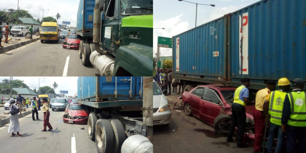 Many escape death as car runs under a trailer laden with 40ft container in Ojuelegba, Lagos