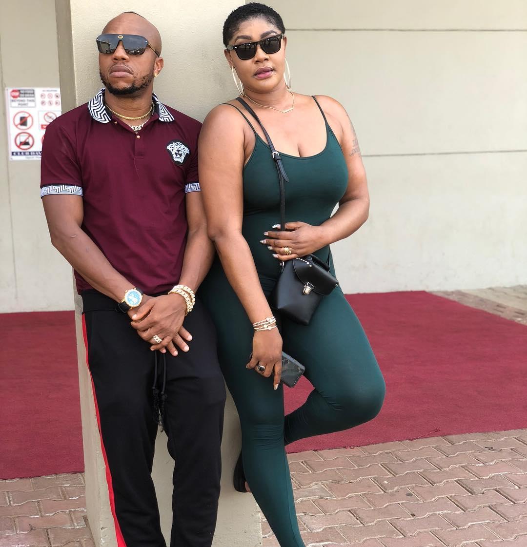 Charles Okocha finally gets some accolade,pictured grabbing Angela Okorie Big Booty