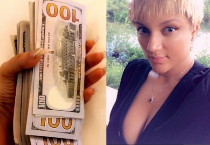 Gifty powers shows off her wads of dollars