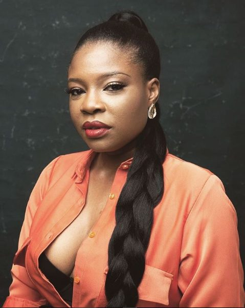 Kemi Adetiba flashes her boobs in cleavage-baring photo