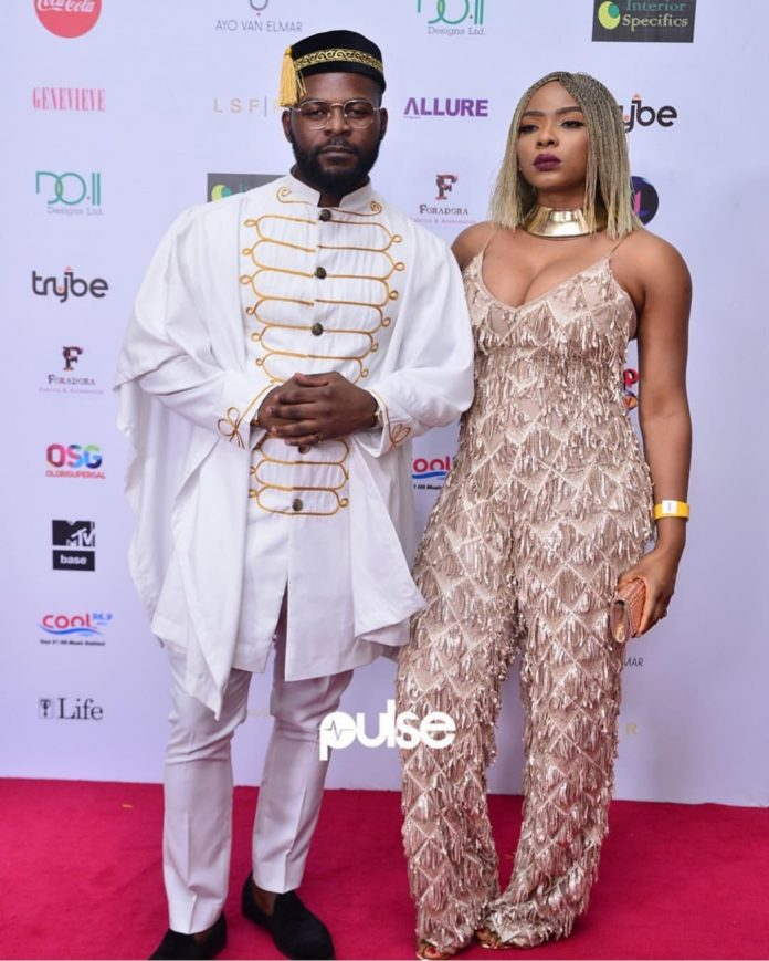 Yemi Alade Steps Out With Falz In Cleavage-Baring Outfit At Chief Daddy Premiere