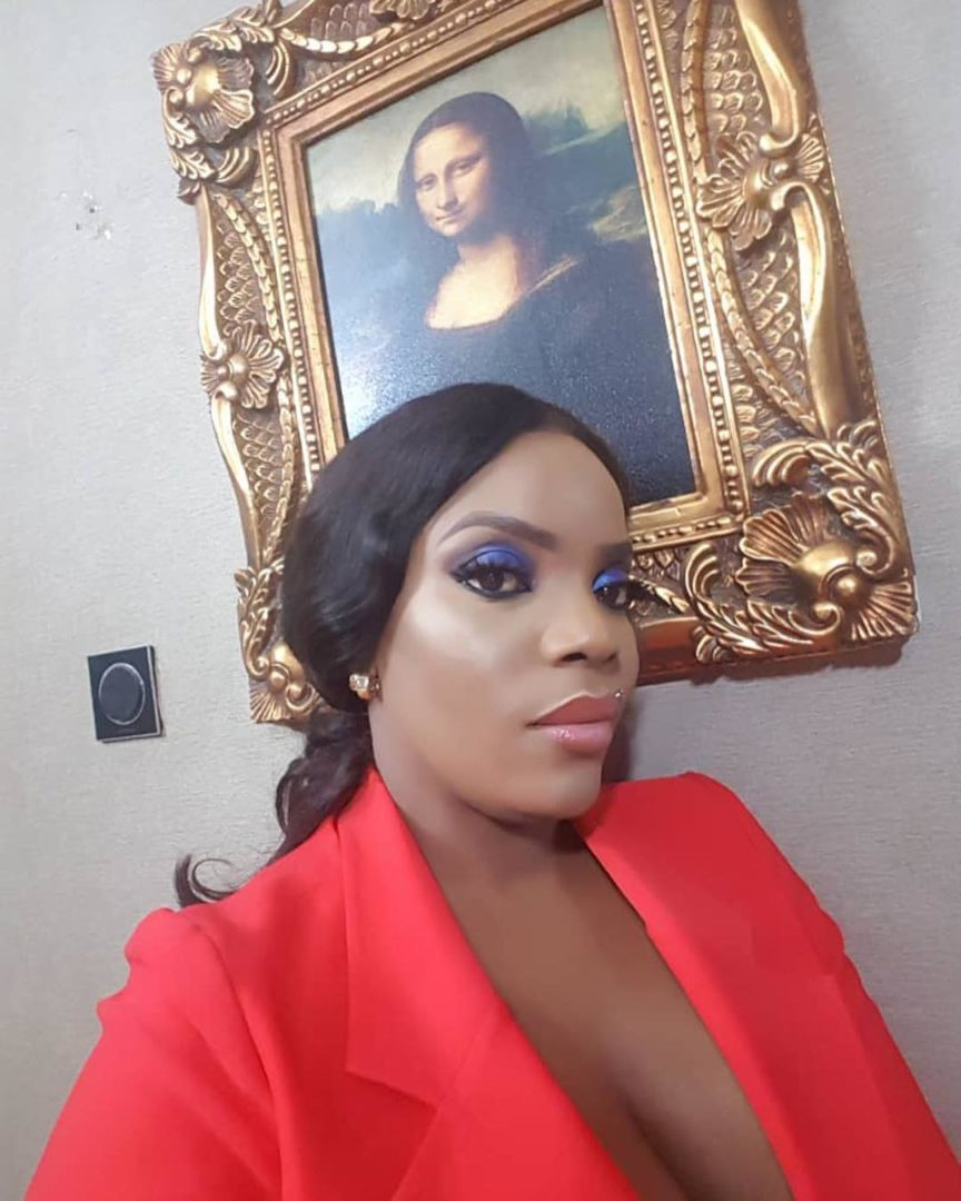 Empress Njamah shows of her big watermelons in Cleavage-Baring Suit