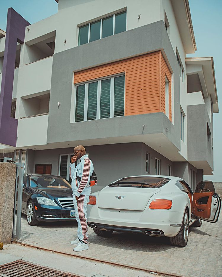 Kizz Daniel Strikes A Pose With His Cars In His New Mansion