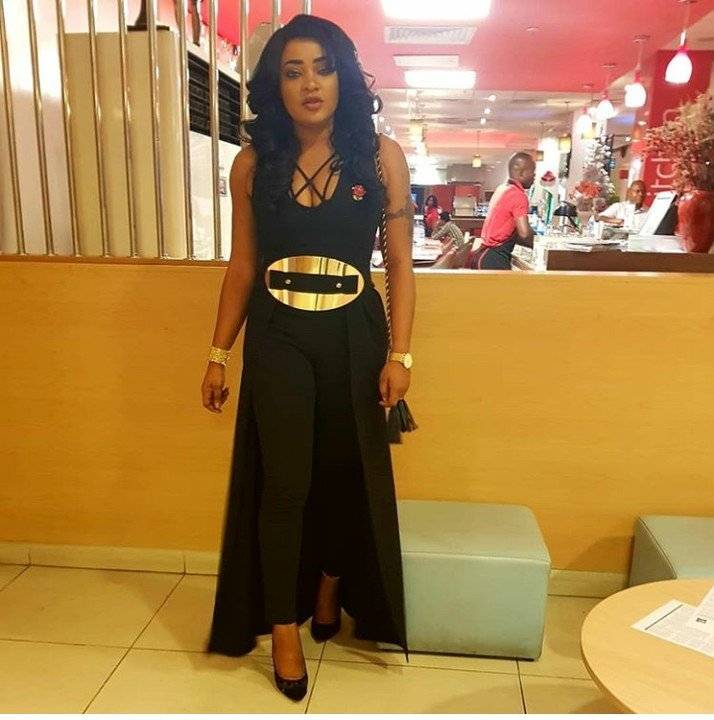 Tayo Sobola Rocks Stylish Cleavage baring Gown To An Event