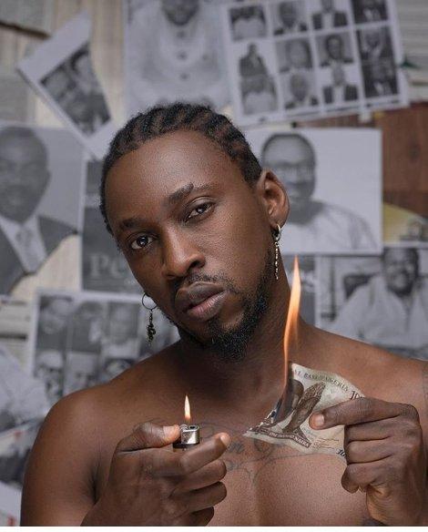 """Born Broke Die Rich"" Orezi Burns 1000 Naira Note In New Photo"