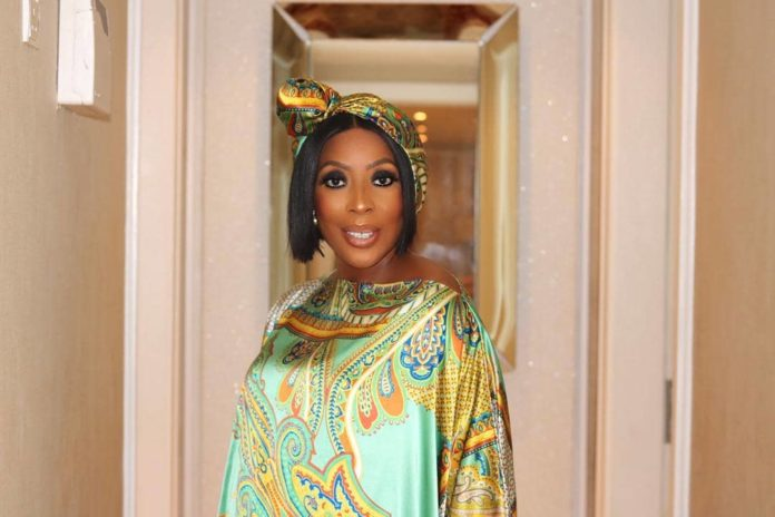 Movie Producer,Mo Abudu shows off her Emmy Awards gold membership card