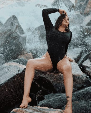 Toyin Lawani goes topless in Semi Nude Pre-birthday Beach Photoshoot