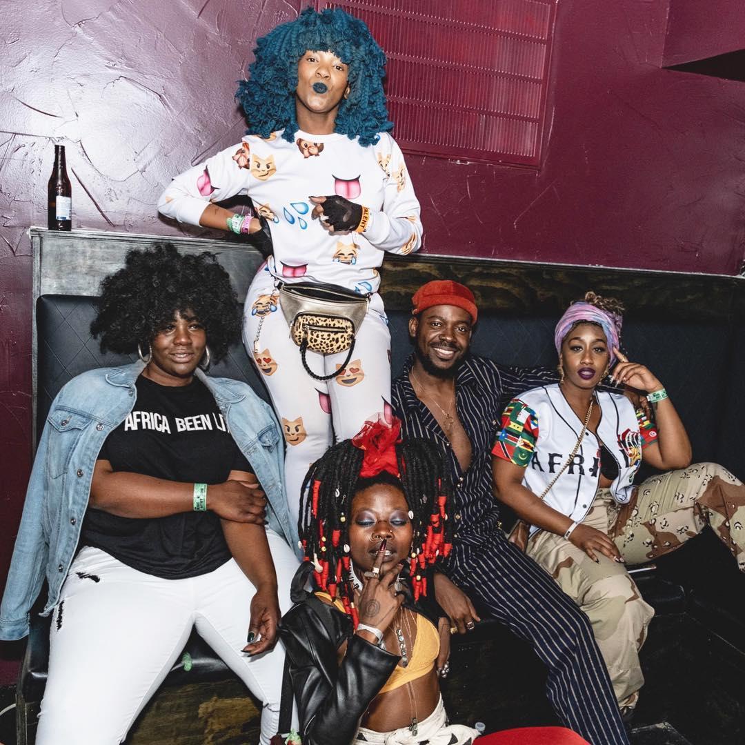"""Photo of Singer Adekunle Gold frolicking four Ladies, calls It """"African Magic"""""""