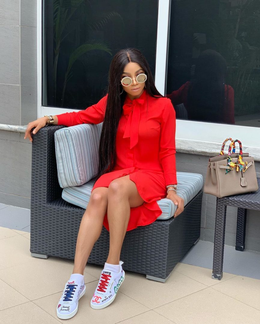 OAP Toke Makinwa Slays In a Red Dress and channel Sneakers, Her Fans Reacted