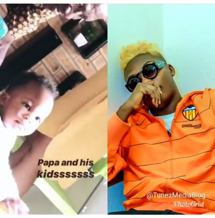 Reekado Banks Shows Off His Father Playing With His son