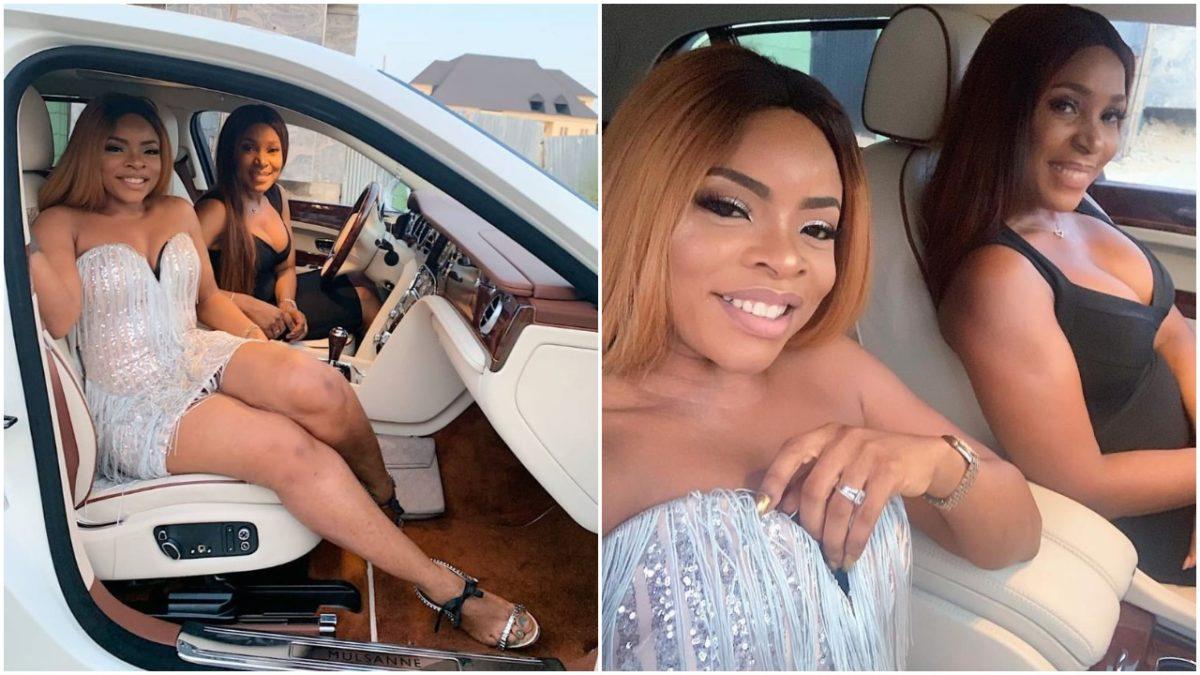Billionaire Blogger Linda Ikeji Poses With Her Sister, Laura In Her Bentley Mulsanne