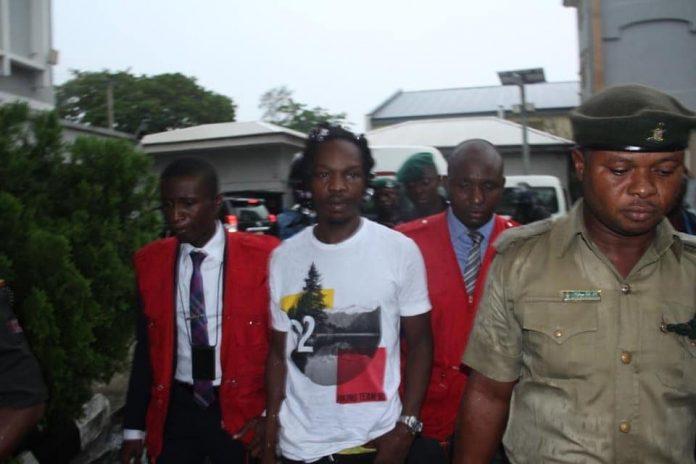 Nigerian Rapper, Naira Marley Remanded in Prison Following Arrangement by EFCC