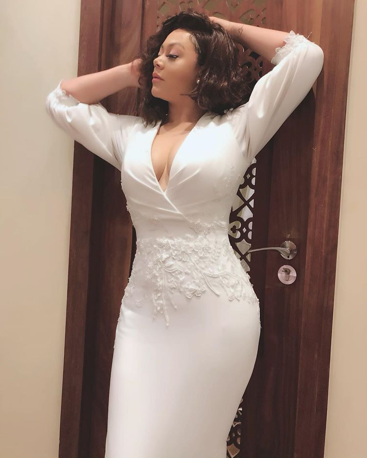 Ghanaian actress, Nadia Buari goes Bra-less in a Cleavage Baring White Dress