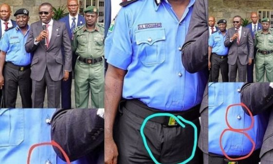 Lagos Deputy Police Commissioner stood beside Governor Sanwo Olu with worn out zipper unclesuru