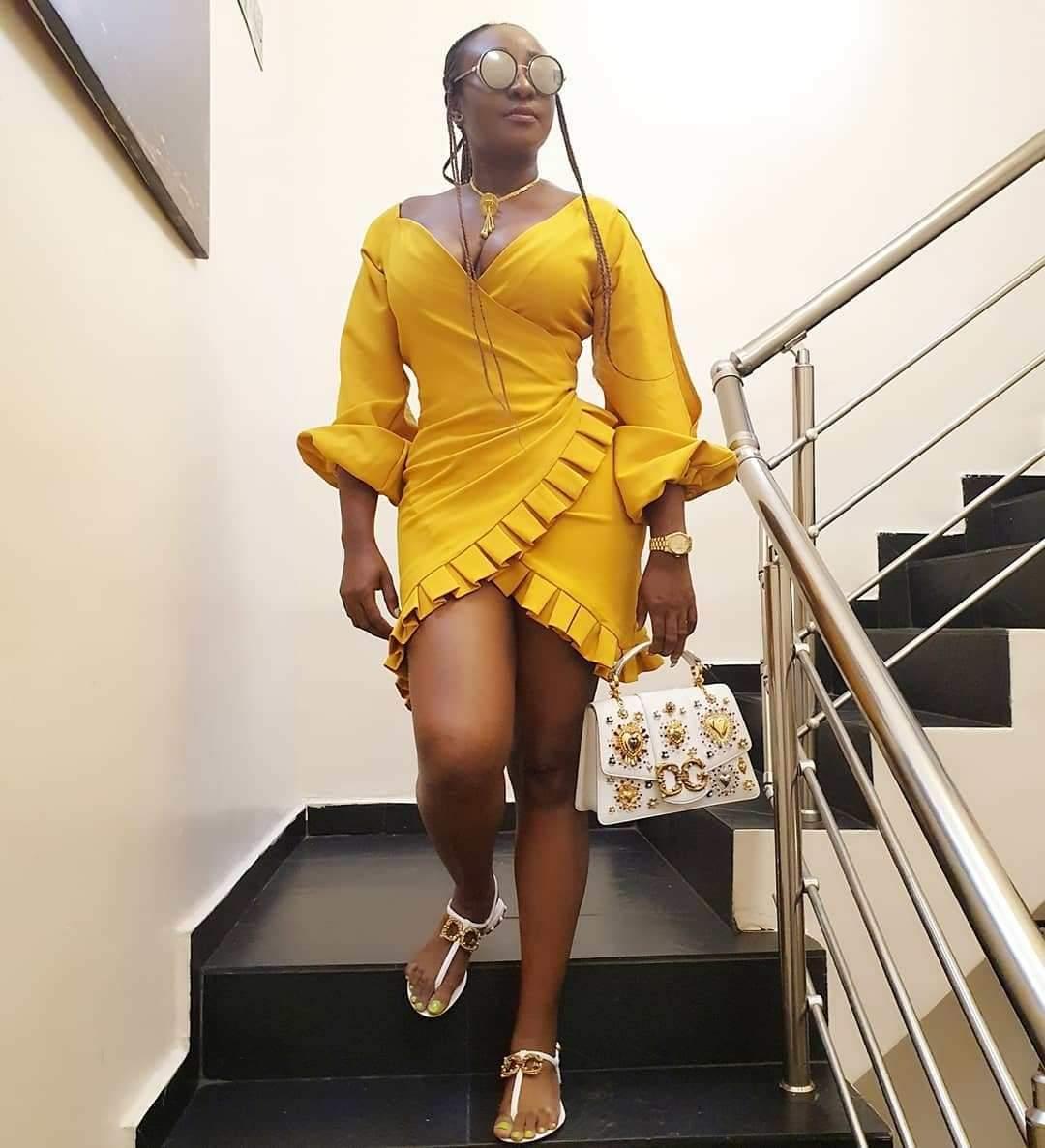Actress Ini Edo Rocks Cleavage-Baring Mini Yellow Dress