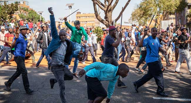 Armed South African Protesters chant on Johannesburg streets asking foreigners to leave their country
