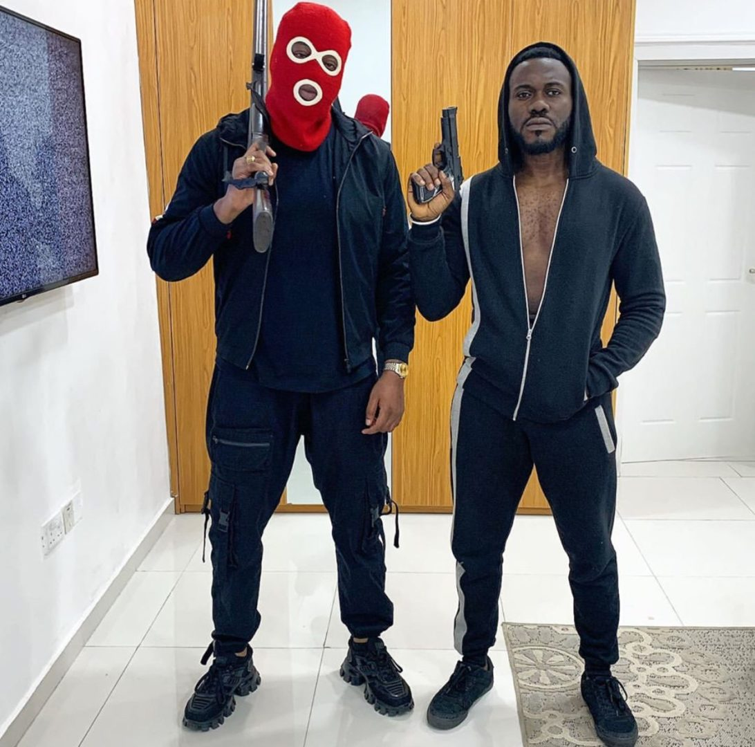 TeddyA and Actor Deyemi looking dope as they pose with Ammunition on set
