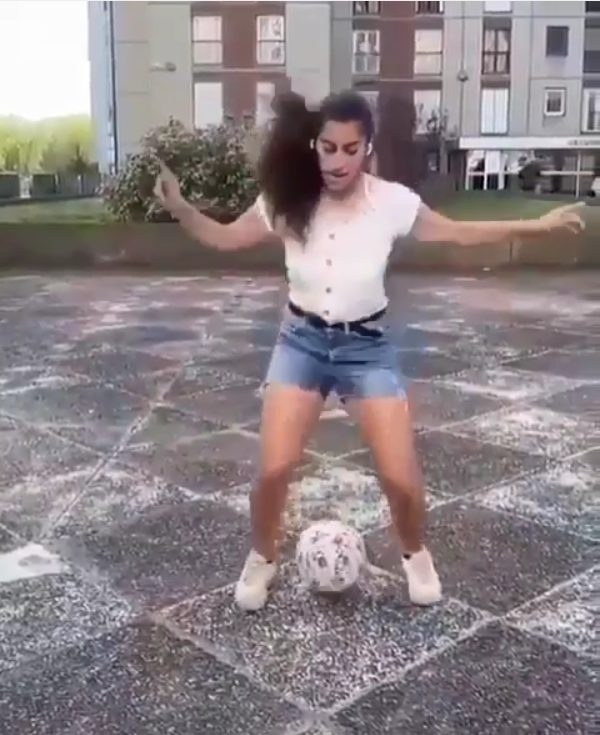 Lady showing skills with juggling soccer ball