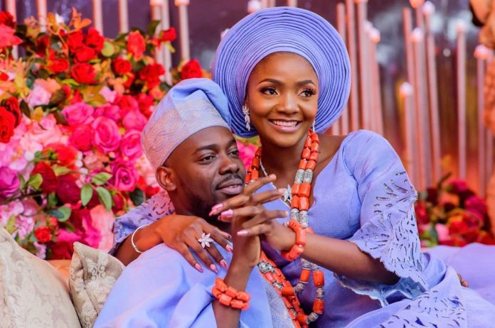 Adekunle Gold reminisce on how he met Simi as they celebrate their 2nd wedding anniversary (Photos)