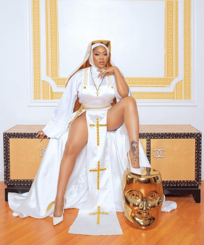Toyin Lawani under fire over controversial Pant-less Nun Outfit (18+Photos)