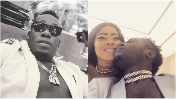 Duncan Mighty finds love again, shares a kiss with his super endowed partner
