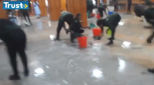 Watch moment cleaners were scooping water out of the National Assembly (video)
