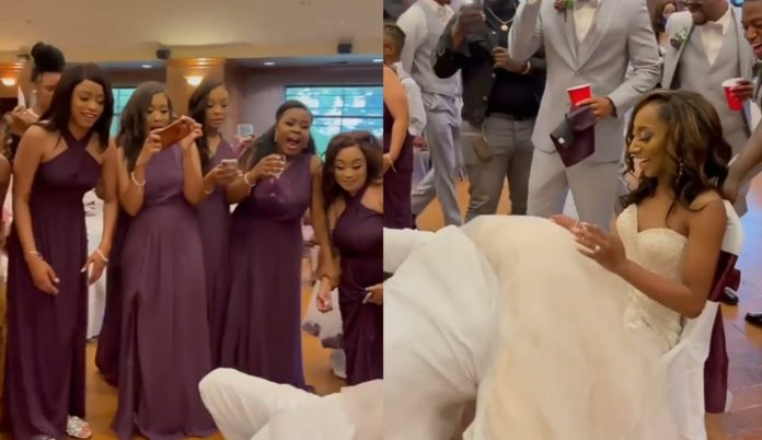 Watch moment Groom performs oral s£x on his bride under people's watch (video)