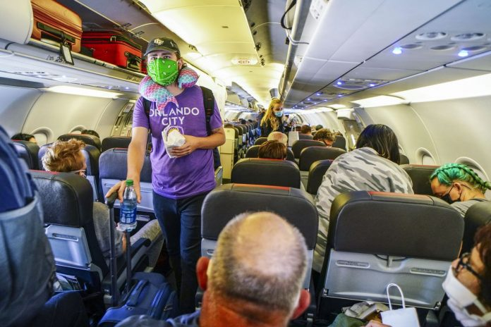 Woman duct taped on flight after she tried to open the door on American Airlines Plane (video)