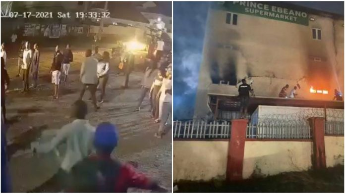 Watch the shocking moment sister of the girl who burnt down Ebeano Supermarket was caught on CCTV smiling during the incidence (video)