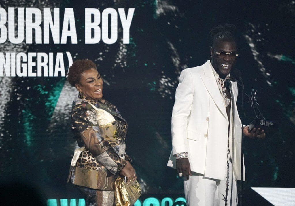 Moment Burna Boy's mother showered him with prayers on his 30th birthday (Video)