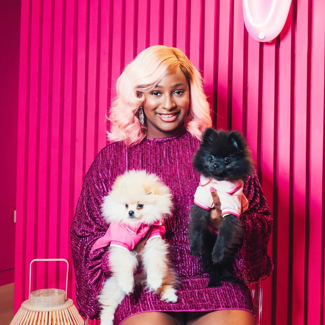 Watch DJ Cuppy's dogs, Dufupoms fight dirty over ownership of her wig (Video)
