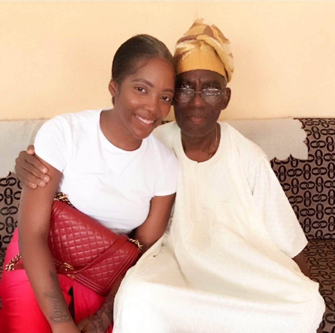 Pray you are watching over me - Tiwa Savage pays a visit to her late father's house (Video)