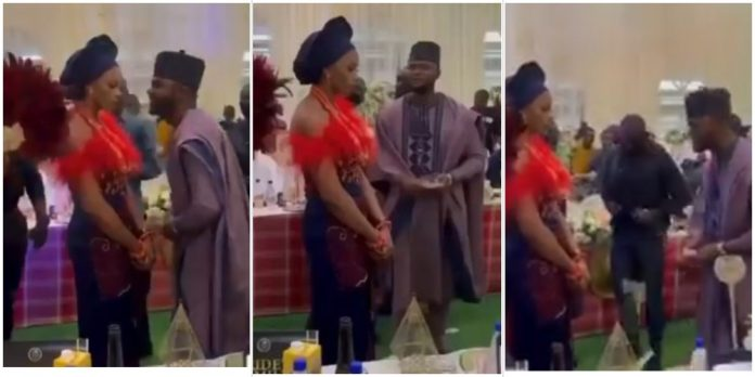 Watch a bride reaction as her husband tries to impress her with money (Video)